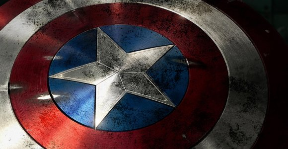 Who gives Captain America his signature, round shield in <em>Captain America: The First Avenger</em>?