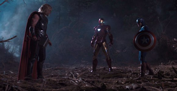 In <em>The Avengers</em>, what hits Captain America's shield, resulting in the flattening of the forest surrounding him?