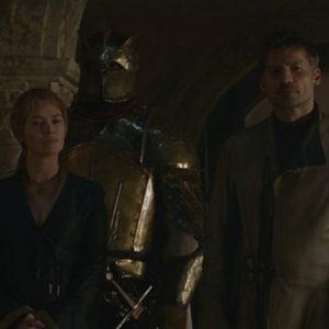 Cersei, Jaime, and the Mountain crash the Small Council meeting.